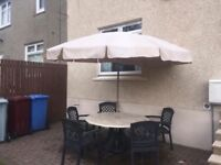 Garden Table, 5 chairs with cushions & parasol