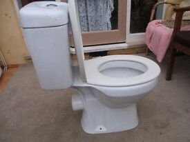 Toilet close fitting in white with seat