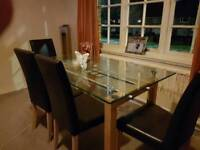 'Next' glass dining table with 4 chairs