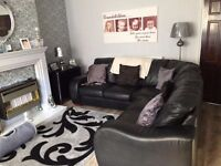 Black leather corner couchs