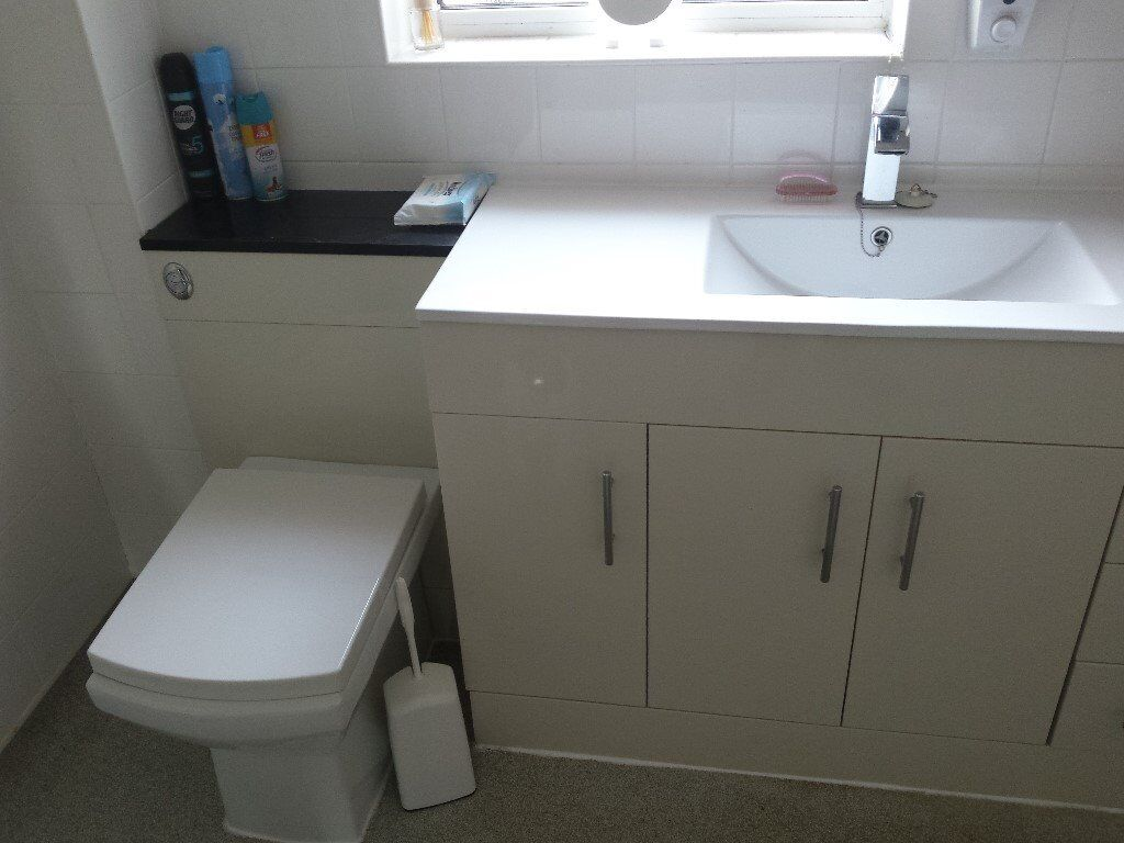 bathroom unit including sink, and tap,,, toilet and electric shower ...