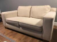 Used cream 2 seater sofa