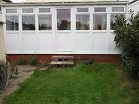 UPVC Conservatory, double glazed with safety glass in larger glazing. 2 side walls, see photo