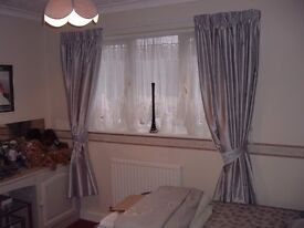 curtains in silver-grey satin effect