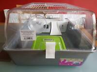 Hamster cage medium plastic(almost new) with some food, bedding and book