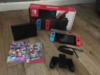 Nintendo switch, in box, excellent condition, with 2 games