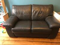 Grey leather 2-seater sofa for sale - £50 ono