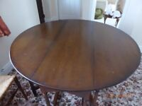 Waring & Gillows Solid Dark Wood Round Drop Leaf Table & 4 Chairs