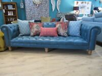 Opulent Blue Leather 3 seater chesterfield sofa with complimentary accent cushions.
