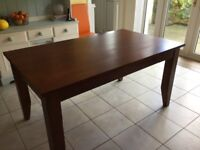 Solid wood dining table.. Always been covered so in pristine condition.