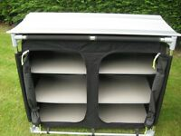 Collapsible wardrobe/storage unit to help ease those accommodation problems when caravanning