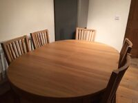 5 months old oak dining table and 6 chairs from ikea.