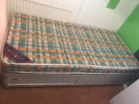 Single bed with mattress sliding doors. Quite old but in good condition, smoke & animal free house.