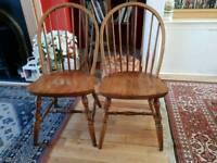 Two wooden farmhouse kitchen chairs
