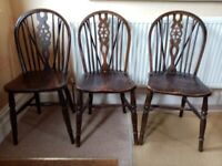 3 vintage wheel back dining chairs