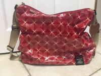 Babymel changing bag (big sloughs twisted red) stylish and in very good condition.