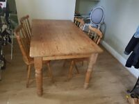 Large farmhouse dining table and four chairs