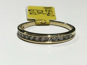 #1542 10K LADIES DIAMOND WEDDING BAND 12 CHANNEL SET DIAMONDS *SIZE 6 1/2* APPRAISED AT $1150.00 SELLING FOR $395.00