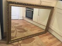 Large wood framed mirror gold coloured frame excellent condition