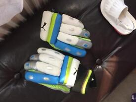 Kids cricket gear, helmet, knee pads and gloves