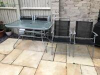 Outdoor Glass dinning table and 6 chairs
