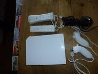 Nintendo Wii and 10 games. Clean and works.