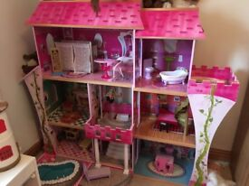 Solid wooden dolls house. Much loved but daughter is growing up.