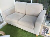 Next beige material 2 seater sofa. From smoke and pet free home.