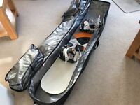 Burton Snowboard Feel Good 147cm with Flow Bindings and DaKine Travel Bag on Wheels