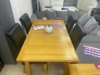 EXTENDABLE DINING TABLE & 4 CHAIRS. £299