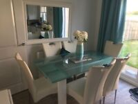 Glass dining table with 6 white leather look chairs