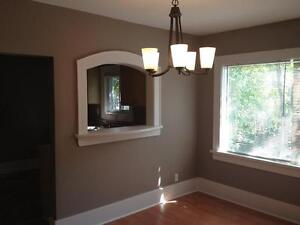 Bright  open concept 2 bd character home/ fenced yard garage
