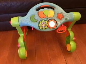 Baby walker and musical activity toy.
