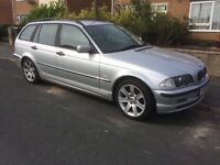 Silver BMW 320d Touring