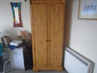 two matching pine wardrobes in v.g.c.