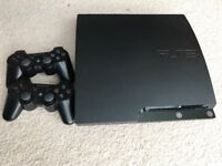 PS3 AND TWO CONTROLLERS IN A VERY GOOD CONDITION