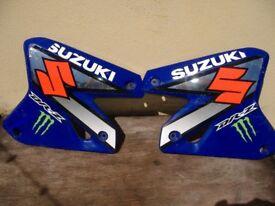 a pair of rad panels for suzuki drz400