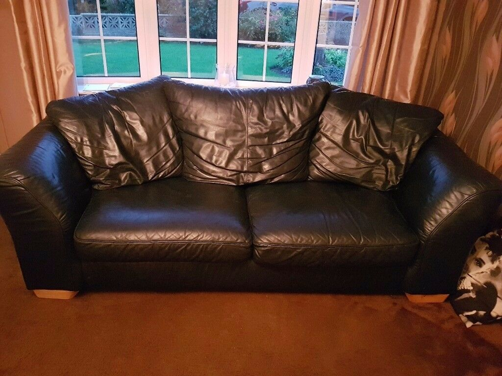 3 seater and 2 seater blue leather sofas.