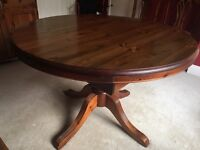 Solid pine extending circular table and 6 chairs