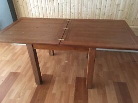 dinning table and chairs solid oak table and solid oak chairs bought for 500 now £250collection only