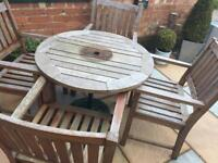 Solid Garden furnitureWooden Table 4 Chairs just needs a good lick of paint or oil .