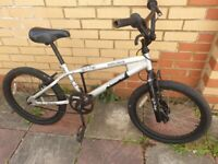 Silver BMX cycle (20inch wheels bike, could use new chain), not free