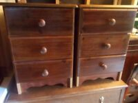 A matching pair of stained bedside cabinets
