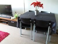 Glass top dining table and chairs. £35 ono.