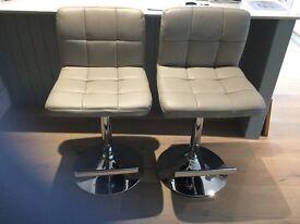 3 grey bar stools