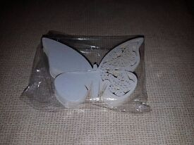 50 pearlescent butterfly over wine glass place names, unopened.