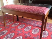 Beautiful reupholstered piano stool. Double with space for music. Quality piece.