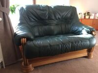 Two seater leather sofa with bucket seats