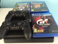PlayStation 4 Console with two remotes and games