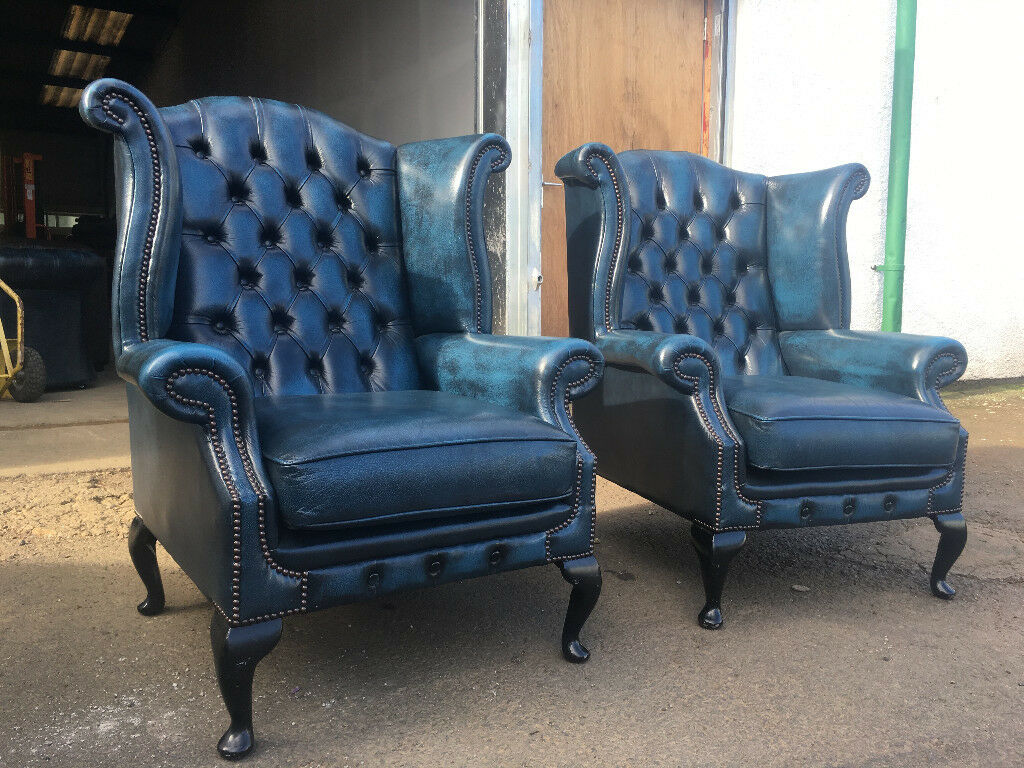 Pair of antique blue chesterfield wing chairs VGC